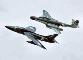 Formation flying - A Gloster Meteor flies in formation with a Hawker Hunter at an airshow in 2009