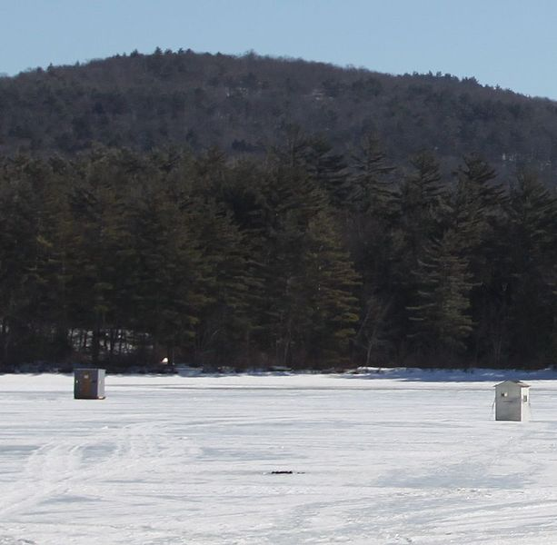 File ice fish huts on the surface of crystal lake for Ice fishing nh