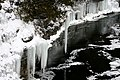 Icicles Into Black Water (3141425873).jpg