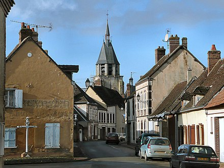 "Illiers, the country town overlooked by a church steeple where Proust spent time as a child and which he described as ""Combray"" in the novel. The town adopted the name Illiers-Combray in homage. Illiers-Combray.jpg"