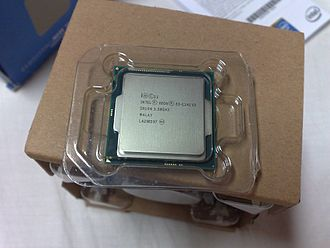 Haswell (microarchitecture) - Intel Xeon E3-1241 v3 CPU, on top of its original packaging with an OEM fan-cooled heatsink