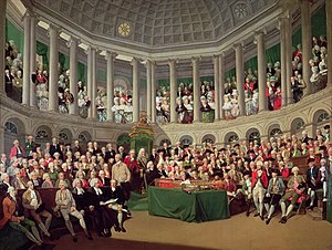 Henry Grattan - The Irish House of Commons by Francis Wheatley (1780) shows Grattan (standing on right in red jacket) addressing the House.