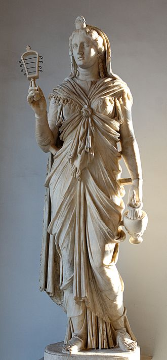 Charge of the Goddess - The goddess Isis, holding a sistrum and oinochoe.
