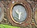 Isle of Man Emblem in a garden in Peel - panoramio.jpg