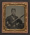 James McGrail in Union uniform with shoulder scales and eagle breast plate sitting with a musket and bayonet in scabbard LOC 5229158648.jpg
