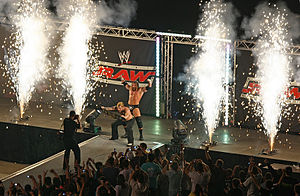 House show - Jeff Hardy and Triple H pose amongst the pyrotechnics at a WWE Raw non-televised event in Australia