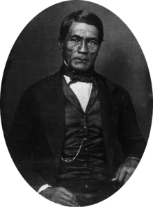 Hawaiian man in western Victorian formal suit