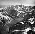 Johns Hopkins and Gilman Glaciers, tidewater glacier terminus with wide lateral moraines and mountain glaciers, August 24, 1963 (GLACIERS 5486).jpg