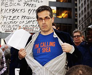 Jonathan Lethem - Lethem reading at Occupy Wall Street; his shirt refers to the New York Mets' home field changing from Shea Stadium, named after William Shea, to CitiField, the naming rights for which were bought by Citibank
