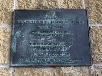 "Light rail in Sydney - The opening plaque for the Inner West Light Rail's Lilyfield extension, which notes the project was ""a joint development of the NSW State Government and the Sydney Light Rail Company""."