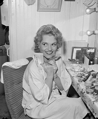 Los Angeles Civic Light Opera - Judy Holliday in her dressing room before the Los Angeles premiere of the Broadway hit Bells Are Ringing with the Los Angeles Civic Light Opera (1959)