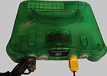 A translucent green Nintendo 64 console with four controller ports in its front.