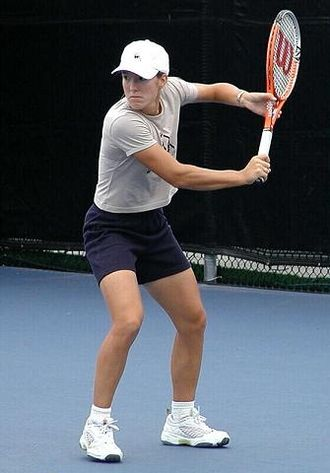 Justine Henin - Justine Henin prepares to hit a backhand