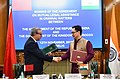 Kiren Rijiju and the Minister of Justice, Government of the Kingdom of Morocco, Mr. Mohamed Aujjar exchanging the documents after signing an Agreement on Mutual Legal Assistance in Criminal Matters between the two countries.JPG
