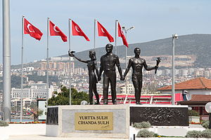 Kuşadası - The Atatürk memorial with Turkish flags in the background