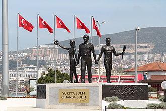 Kuşadası - The Atatürk memorial with Turkish flags in the background