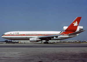 LAM Mozambique Airlines - A France-registered McDonnell Douglas DC-10-30 wearing LAM Mozambique Airlines markings is seen here at Charles de Gaulle Airport in 1983.