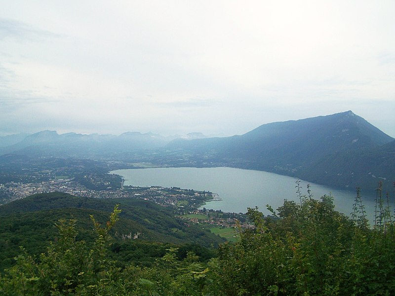Broad landscape on the Lac du Bourget (Bourget lake) and the city of Aix-les-Bains in Savoie, France since the Corsuet forest.
