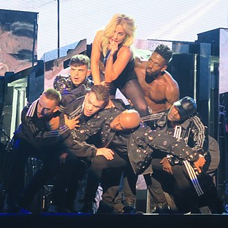 "John Wayne (song) - Gaga performing ""John Wayne"" at the 2017 Coachella festival, astride a human pyramid formed by her dancers"