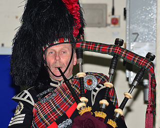 Feather bonnet military headdress formerly worn by the Scottish Highland infantry regiments of the British Army; now worn by pipers and drummers