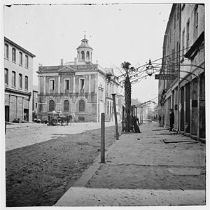 """Charleston in the American Civil War - View of Post Office (Now """"Old Exchange Building""""), East Bay Street, Charleston, 1865, showing the last palmetto left in the city after the bombardment"""