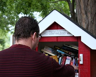 Little Free Library - A reader browsing a Little Free Library
