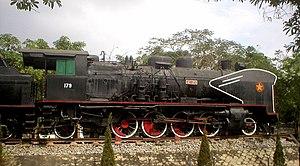 Vietnam Railways - Old locomotive exhibited in Vinh railway station.