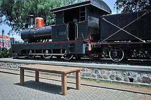 Locomotive and Teak Table in front of Lawang Sewu building, Semarang