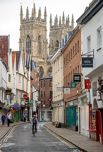 Low Petergate with the Minster towers in the background Lower Petergate in York, England.jpg