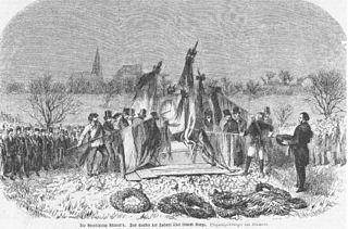 Beerdigung Ludwig Uhlands auf dem Tübinger Stadtfriedhof, Das Senken der Fahnen über dem Sarge, Zeitgenössischer Holzstich (Quelle: Wikimedia)