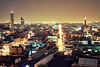 Ciudad de México at night, with a brightly illuminated sky.