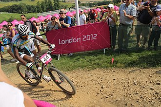 "Adrien Niyonshuti, ""one of the most famous people in Rwanda"", competing in the cross-country mountain biking event at the 2012 Summer Olympics MTB cycling 2012 Olympics M cross-country RWA Adrien Niyonshuti.jpg"