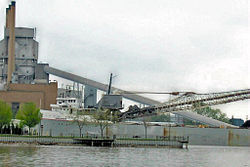 Gray freighter unloading at dockside