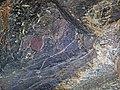 Magnetite-rich banded iron-formation (BIF) (Michipicoten Iron-Formation, Neoarchean, 2696-2749 Ma; Route 17 roadcut east of Bridget Lake, south of Wawa, Ontario, Canada) 4 (48268682486).jpg