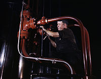 Maintenance man at the Combustion Engineering Co working at the largest cold steel hydraulic press in the world, Chattanooga, Tenn.jpg
