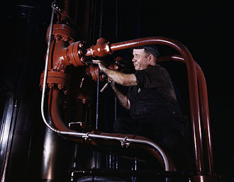 Combustion Engineering - Maintenance man at the Combustion Engineering Co working at the largest cold steel hydraulic press in the world, Chattanooga, Tenn. (1942)