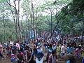 Malayalttoor Kurishumudi People Climbing hill.JPG