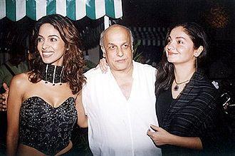 Pooja Bhatt - Bhatt (right) with her father Mahesh Bhatt and actress Mallika Sherawat in 2004.