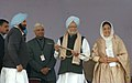 Manmohan Singh received a 'Saropa' from the Chief Minister of Punjab Capt. Amarinder Singh at the foundation stone laying ceremony of Guru Ram Dass Water Supply & Sewerage Project, Amritsar; four laning over of Wagha Road.jpg