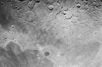 Mare Frigoris - Lunar Orbiter 4 image of Mare Frigoris and vicinity.  This regional view is nearly orthogonal at top but highly oblique at bottom, and north is up and slightly to the right.  Mare Frigoris is the dark band extending from upper left to lower right.  Mare Imbrium and Sinus Iridum are in lower left.  Prominent craters include Plato with dark flat floor in bottom center, Harpalus near left edge within the mare, Philolaus at top center, and Aristoteles in lower right within the mare.