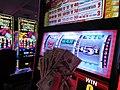 Marijuana joint with cash in front of slot machine.jpg