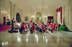 The Marine Band plays in the White House Entrance Hall in honor of Prime Minister Margaret Thatcher of the United Kingdom's state visit, 1988