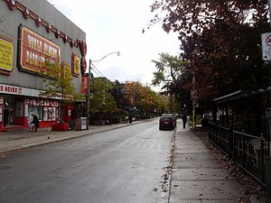 Palmerston–Little Italy - Victorian homes share space with Honest Ed's on Markham Street.