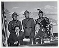 Mayor John F. Collins sits with an unidentified man, behind them are two Canadian Mounties and an Irish bagpiper (12773915515).jpg