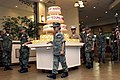 Members from the Camp Courtney Young Marines escort the birthday cake.jpg