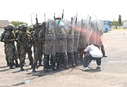 Members of the Ghana Army 2nd Engineer Battalion prepare to practice riot control techniques during a nonlethal training demonstration June 26, 2013, in Accra, Ghana, as part of exercise Western Accord 2013 130626-A-ZZ999-023