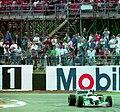Michael Schumacher - Benetton 194 exits Luffield at the 1994 British Grand Prix (31697616904).jpg