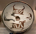 Mimbres Bowl with two bighorn sheep human head and figure DMA 1990-219-FA.jpg