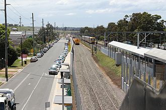 Southern Sydney Freight Line - Minto station looking north in December 2012 during the final stages of construction