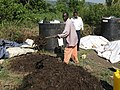 Mixing the compost heap manually (6881921633).jpg